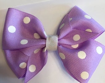 Purple and white polka dotted hair bow