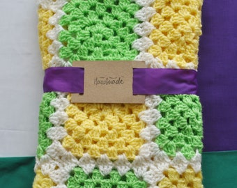 Handmade crochet lemon and lime baby blanket. Perfect for use in cots, prams or just to wrap them in.