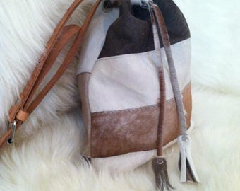 Cowhide Cinch Cross Body Sling Bags
