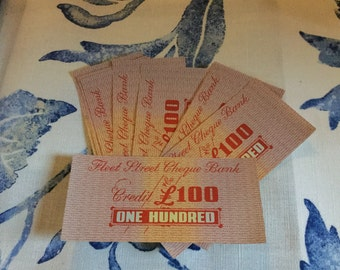 10 banknotes from 1950s boardgame. Ideal for play money or craft projects.