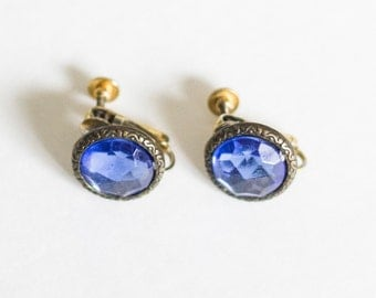 Gold toned and blue crystal screw back earrings