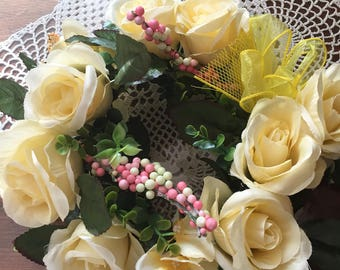 Cream colored flowers   with yellow bow and mess   Handade in usa    Soft gentle look