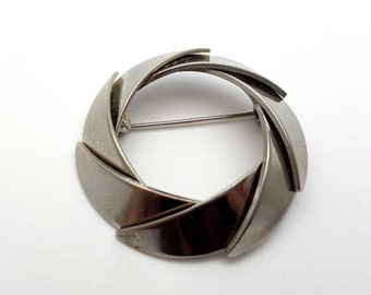 Unadorned Modern Wreath Silver tone Metal Vintage from the 90s Runway Statement Piece