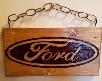 Burned Ford Sign