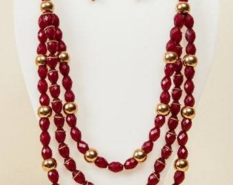 Maroon and gold beaded necklace.