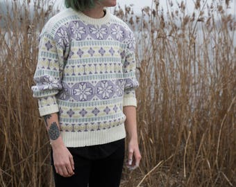 Knitted sweater with pastel pattern