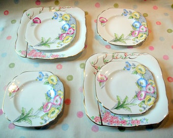 Collection of vintage plates on a 1930's floral and handpainted theme.