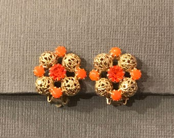 Orange glass and gold beaded clip earrings