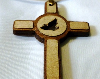 Custom laser engraved wood cross pendant witha cut out dove. 22 inch leather necklace with a 2 inch chain extension