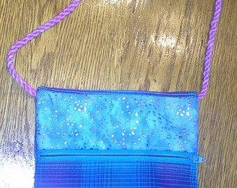 "Blue and rose plaid cotton bag. Trim of teal cotton with rose iridescent sparkle.  Hand twisted 36"" rope handle."