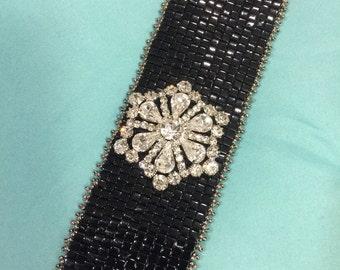 Handwoven beaded bracelet with vintage rhinestone pin