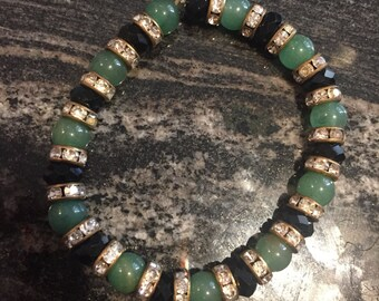 Beaded stretch bracelet with jade and black crystal beads.