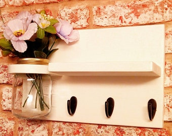 Shelf with mason jar and key hooks