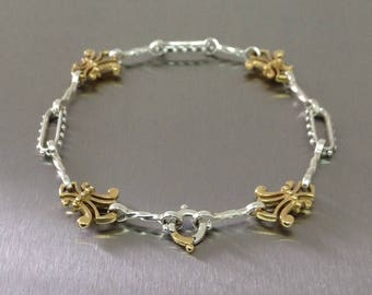 Silver and Gold fleur de lis bracelet.