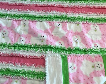 Very pretty three layer flannel rag quilt.  White puppies with pink and green.  Warm and cozy.  40x52