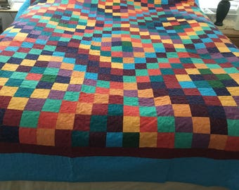 72x92 machine sewn and quilted quilt, in vibrant colors twin size.