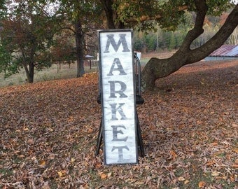 "Distressed Wooden ""MARKET"" sign."