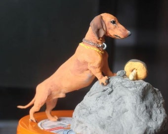 The figurine of the dog breed Dachshnud,statuette,sculpture,hunting dog