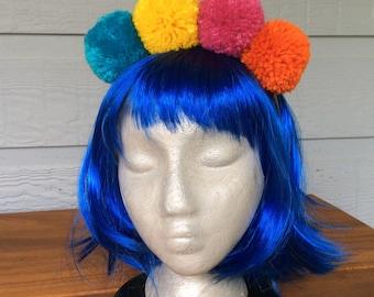 Brightly coloured wool pompom headband
