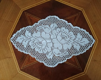 oblong doily with flower pattern