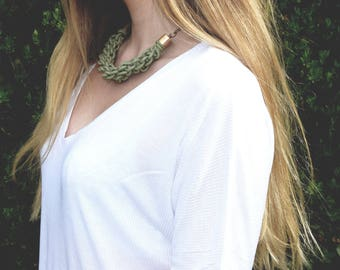 Green knot statement necklace