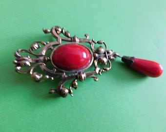 Large brooch.