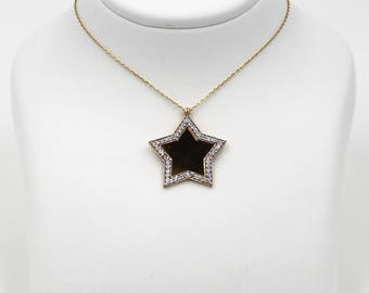 14k Gold Star Necklace with white sapphire