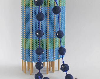 """Long necklace """"Pounding"""" with needle felted beads by hand. The heart and the beads are decorated with shimmering beads."""