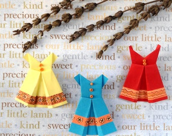 Clothes origami, paper clothes, paper clothes, miniature clothing, red dress, yellow dress, blue dress.