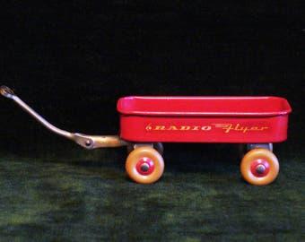 1964 New York World's Fair Miniature Radio Flyer Wagon W/ House of Good Taste Ad Misprint