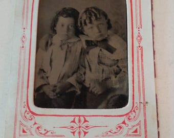 You've Got a Friend:  Antique Tintype Photograph of Two Children With Curls in Paper Frame