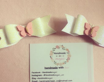 Pair of glitter bow butterfly clips