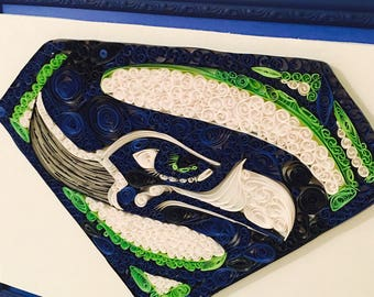 Seattle Seahawks quilled paper in picture frame.