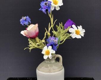 Field flowers in soft blue jug