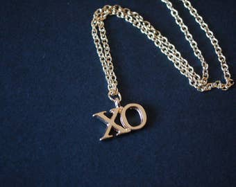 gold tone XO kiss kiss necklace