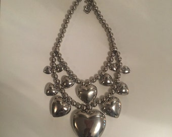 Silver layered queen of hearts love chunky statement necklace.