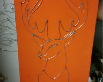 Wire Buck With Orange Background on Wood