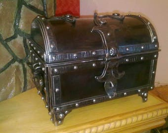 Decorative box with forged metal. On the rivets. Handmade.Manual forging