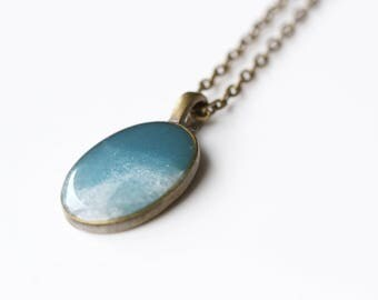 A watery blue resin pendant