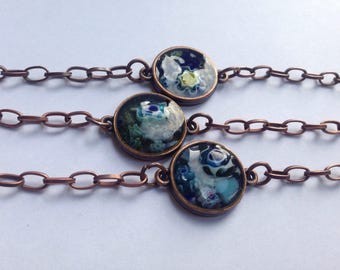 Copper bracelet with navy blue yellow and green glass and millefiore set in resin