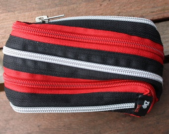 silver red and black horizontal zip pouch