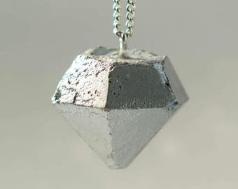 Diamonds, concrete, silver chain