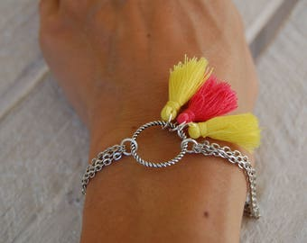 Yellow and pink circle and yellow tassel bracelet