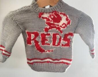 Sports team handknitted baby jumper