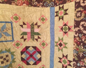 Hand-made quilt in the legacy sampler pattern-a Civil War era recreation.