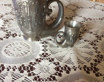 1x small and 1x large tin cup with unusual execution