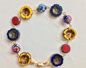 Czech glass flower bracelet. Red, yellow and blue beads. Italian millefiori bead accents.