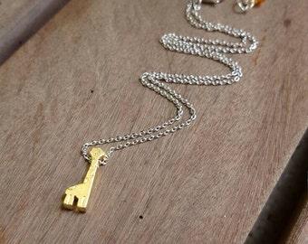 Giraffe and a Half necklace || brass, Swarovski, silver