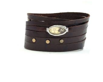 Shi Bandit Cuff: Brown Leather Wrap Cuff with Brass Studs and Silk Charm