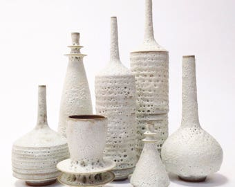 Made to order - large collection of 7 sculptural modern stoneware ceramic vases in white crater lava glaze by sarapaloma